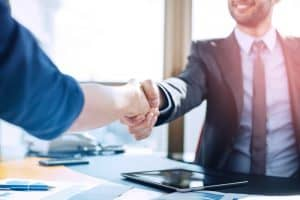 Executive And Assistant Handshake
